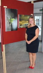 Anneke Polak in front of her pieces of art